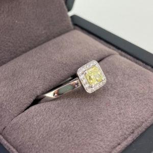 0.55 Carat Yellow Diamond Halo Engagement Ring