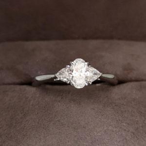 0.62 Carat Platinum Oval Cut Three Stone Diamond Ring