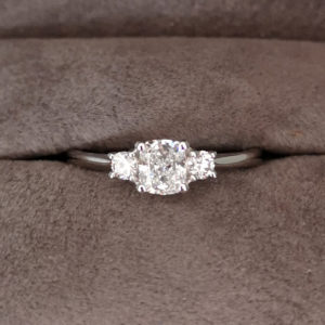 0.63 Carat Platinum Cushion Cut Three Stone Diamond Ring