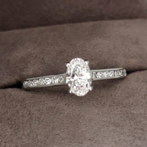 0.69 Carat Oval Cut Diamond Solitaire Ring with Channel Set Shoulders